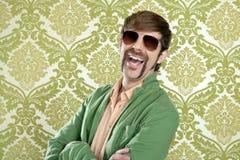 Geek retro salesperson man funny mustache. Sunglasses in green wallpaper stock photos