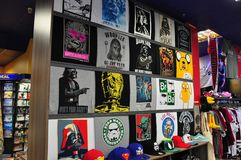 Geek shop. Pictures of popular universes on shirts royalty free stock photos