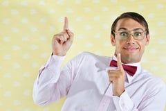 Geek som pekar upp Royaltyfri Bild