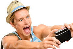 Geek tourist man photographing vintage camera isolated on white Stock Image