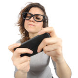 Geek woman playing with a smart phone Royalty Free Stock Photo