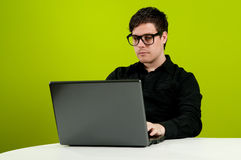 Geek working on computer Stock Photo