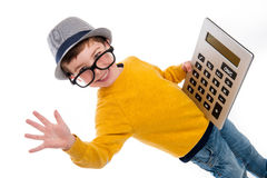 Geeky Boy with Big Claculator. Geeky toddler boy with big calculator, big glasses and wearing a hat. Studio shot isolated on white Stock Photos