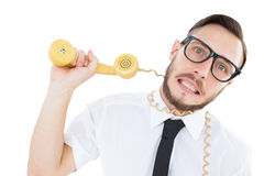 Geeky businessman being strangled by phone cord Royalty Free Stock Photo
