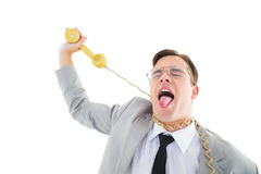 Geeky businessman being strangled by phone cord Royalty Free Stock Photography