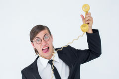 Geeky businessman being strangled by phone cord Royalty Free Stock Image