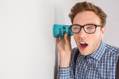 Geeky businessman eavesdropping with cup Royalty Free Stock Image
