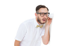Geeky businessman eavesdropping with cup Royalty Free Stock Photos