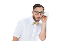 Geeky businessman eavesdropping with cup Stock Photos