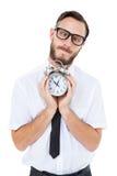 Geeky businessman holding alarm clock Stock Photography
