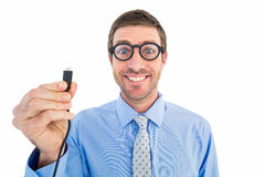 Geeky businessman holding a cable Royalty Free Stock Photos