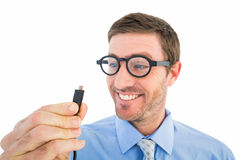 Geeky businessman holding a cable Royalty Free Stock Photo