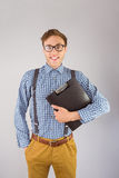 Geeky businessman holding a clipboard Royalty Free Stock Photography