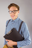 Geeky businessman holding a clipboard Stock Images