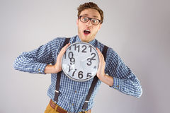 Geeky businessman holding a clock Stock Images