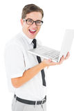 Geeky businessman holding his laptop Royalty Free Stock Images