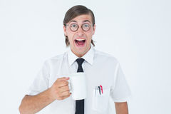 Geeky businessman holding a mug Stock Images