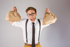 Geeky businessman holding paper bags Stock Photos