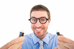 Geeky businessman holding two cables Royalty Free Stock Images
