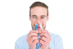 Geeky businessman holding two cables Royalty Free Stock Image