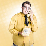 Geeky businessman on important phone call Stock Photography