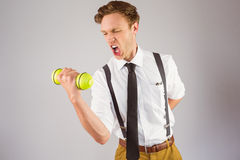 Geeky businessman lifting a dumbbell Royalty Free Stock Photography