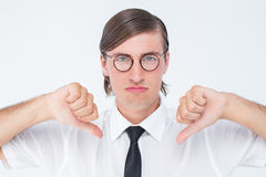 Geeky businessman looking at camera thumbs down Stock Photos