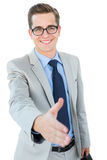 Geeky businessman offering his hand Royalty Free Stock Photo
