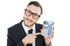 Geeky businessman pointing to calculator Stock Photo