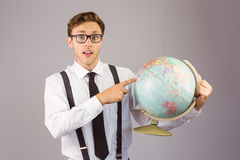 Geeky businessman pointing to globe Royalty Free Stock Photo