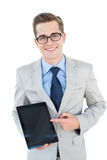 Geeky businessman pointing to tablet pc Royalty Free Stock Image