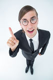 Geeky businessman pointing up Royalty Free Stock Image