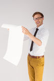 Geeky businessman reading large page Royalty Free Stock Image
