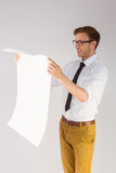Geeky businessman reading large page Royalty Free Stock Photo