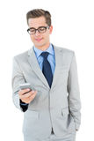 Geeky businessman sending a text Stock Photos