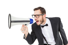 Geeky businessman shouting through megaphone Royalty Free Stock Photos