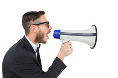 Geeky businessman shouting through megaphone Royalty Free Stock Photo