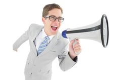 Geeky businessman shouting through megaphone Stock Photography
