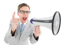 Geeky businessman shouting through megaphone Royalty Free Stock Images
