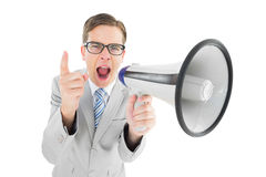 Geeky businessman shouting through megaphone Stock Images
