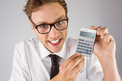 Geeky businessman showing a calculator Stock Image