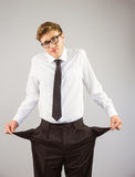 Geeky businessman showing his empty pockets Royalty Free Stock Photography