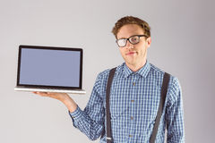 Geeky businessman showing his laptop Stock Image