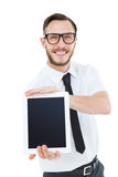 Geeky businessman showing his tablet pc Stock Photography