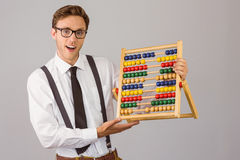 Geeky businessman using an abacus Royalty Free Stock Photo