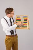 Geeky businessman using an abacus Royalty Free Stock Image