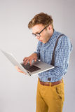 Geeky businessman using his laptop Royalty Free Stock Image