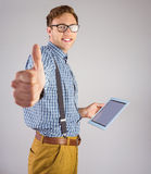 Geeky businessman using his tablet pc Royalty Free Stock Photo