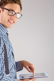 Geeky businessman using his tablet pc Royalty Free Stock Image