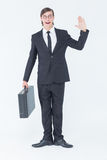 Geeky businessman waving at camera Royalty Free Stock Images
